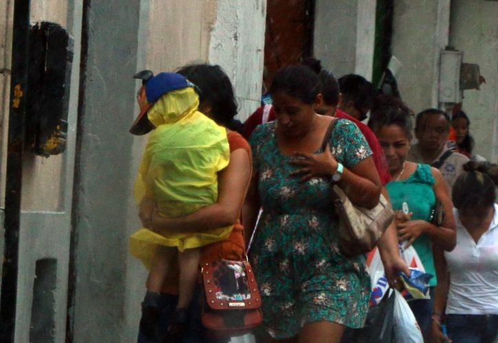 Los meridanos sufrieron en este inicio de semana fuertes chubascos, los cuales dejaron grandes cantidades de agua sobre las calles. (José Acosta/ Milenio Novedades)