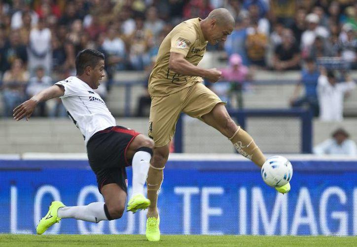 Pumas sufrió su tercer revés consecutivo del Apertura 2014 al caer 1-0 ante el Atlas. (AP)