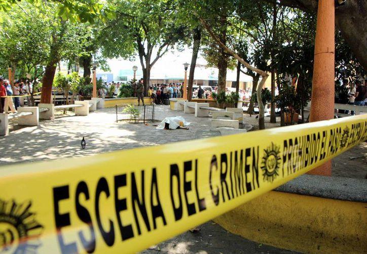 Las autoridades trataron de minimizar el homicidio alegando que el joven era empleado de una empresa de cable. (AP)