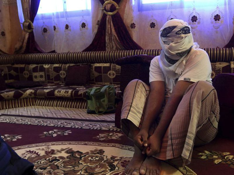 A former Yemeni detainee shows how he was kept in handcuffs and leg shackles while he was held in a secret prison at Riyan airport in the southern city of Mukalla. (AP Photo/Maad El Zikry, File)