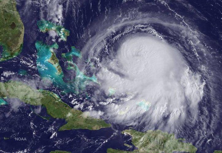 Fotografía facilitada por la Administración Oceánica y Atmosférica Nacional (NOAA, en sus siglas en inglés), que muestra una imagen satélite tomada por el GOES del huracán Joaquín a su paso por el Mar Caribe. (EFE)