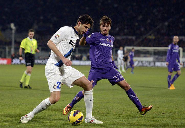 El cancerbero del Inter de Milán, Samir Handanovic, tuvo una actuación sobresaliente al atajar los embates del equipo que viste en violeta. (Contexto/ Internet)