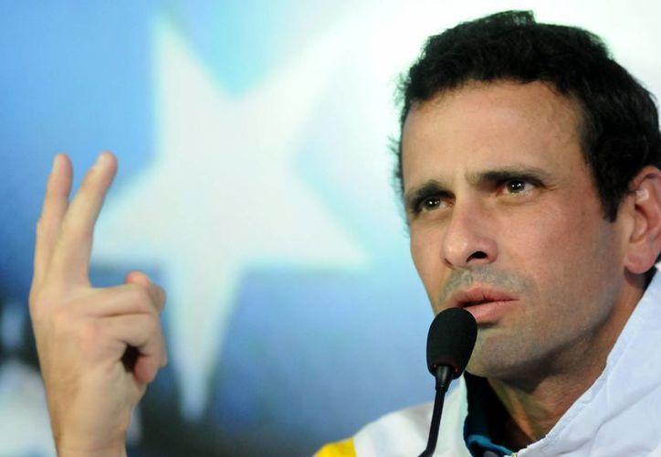 Capriles ofreció disculpas a la familia de Chávez por cuestionar la fecha de la muerte del mandatario. (EFE)