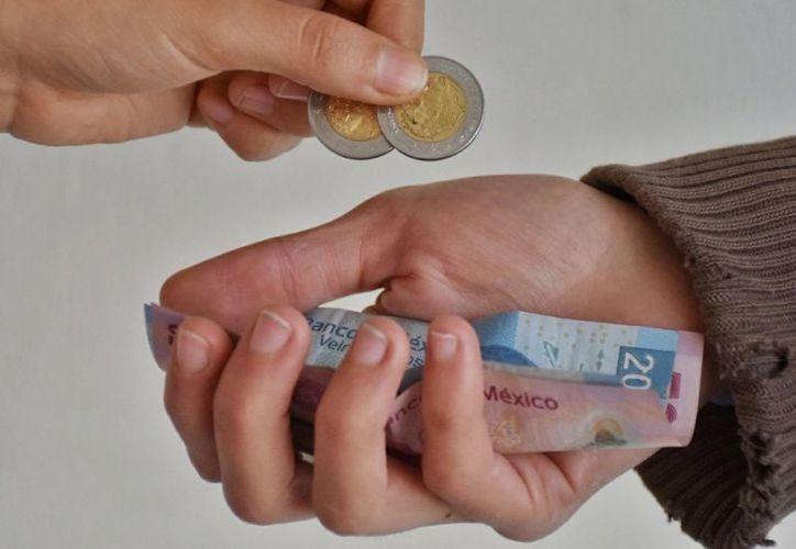 Los salarios no llegarán a los 90 pesos en el próximo ajuste. (MiMorelia)