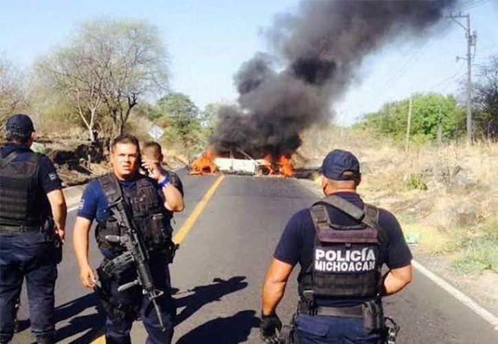 Luego de tres días de bloqueos carreteros e incineración de vehículos en Michoacán, hay 33 detenidos (Miguel Garvía Tinoco/Excelsior)