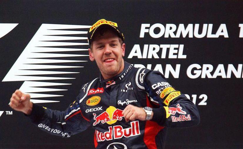 Ecclestone llamó a Vettel un ganador. (Foto: EFE)
