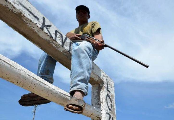 Mientras las autodefensas avanzan en varios puntos de Michoacán, el nuevo vocero es Estanislao Beltrán en vez de José Manuel Mireles. (Notimex/Archivo)