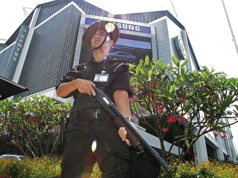 A Gurkha police officer stands guard outside the venue of the IMF-World Bank meetings in Singapore.