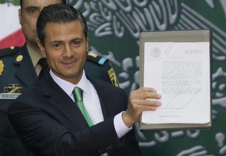 El presidente Enrique Peña Nieto promulgó el viernes la reforma energética. Este sábado entrará en vigor. (Archivo/Notimex)