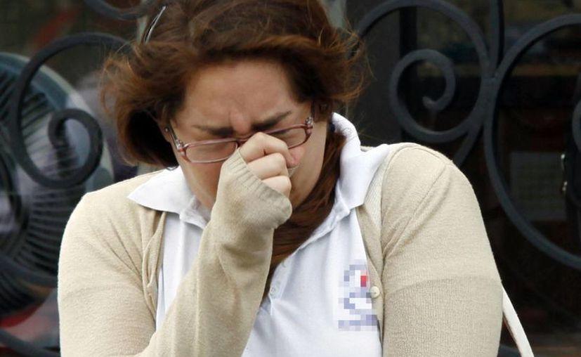 En la etapa aguda del chikungunya el paciente presenta mucho dolor articular y demás síntomas como dolores musculares, dolores de cabeza, náuseas, cansancio y erupciones cutáneas que durar un largo período. Imagen de contexto de una joven en el centro de Mérida. (Milenio Novedades)