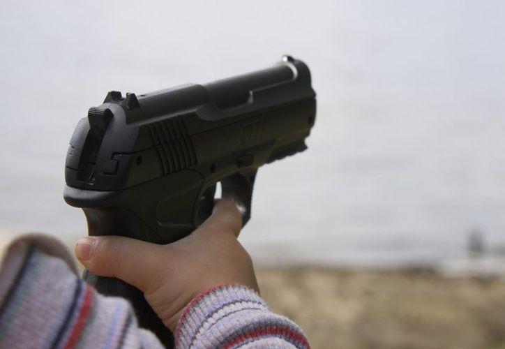 El niño  jugaba con el arma en una cama donde su padre dormía. (Foto: Contexto/Vanguardia)
