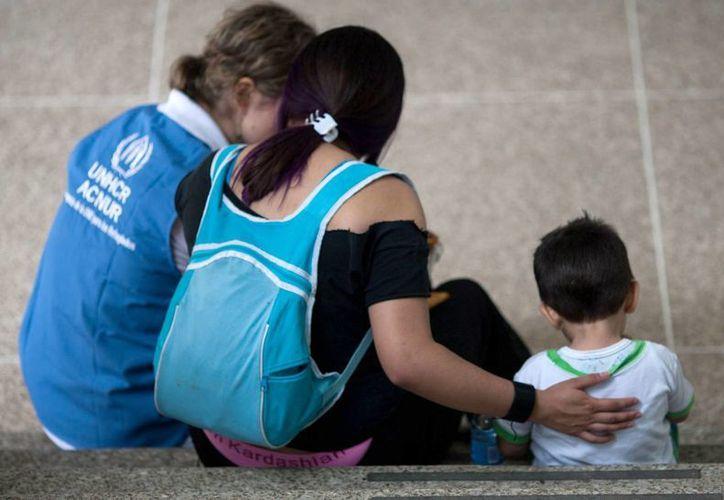 La ONU calcula que 20 millones de personas están actualmente refugiadas en países distintos al suyo por los conflictos armados en su nación de origen. (EFE/Archivo)