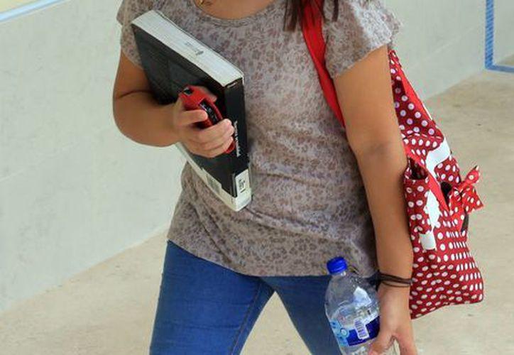 El posicionamiento de Yucatán como un polo educativo a nivel nacional y mundial ha incrementado la residencia de jóvenes en la entidad. Imagen de contexto. (Milenio Novedades)