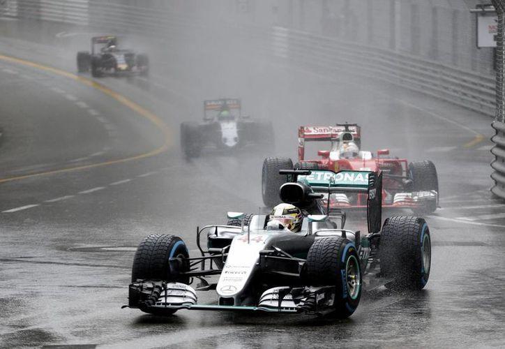Lewis Hamilton, actual campeón, logró precisamente en Montreal su primera victoria en el Mundial de Fórmula Uno, circuito donde este fin de semana se corre el Gran Premio. (Archivo/ AP)