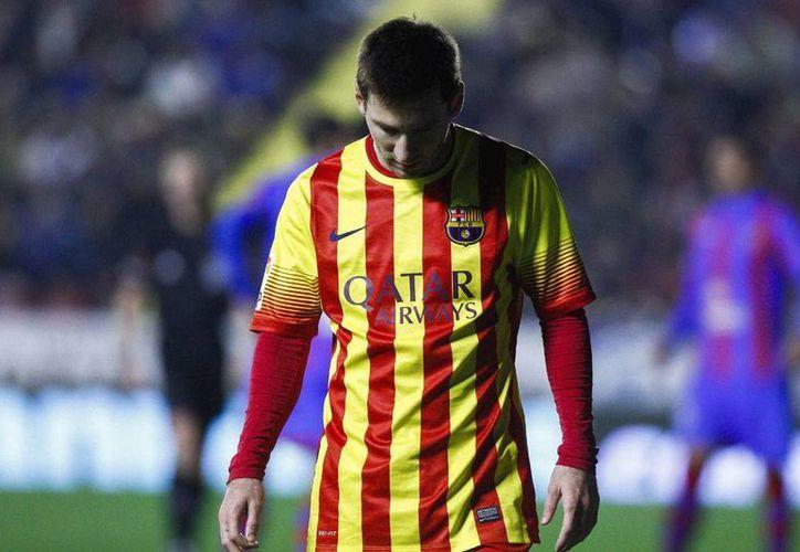 El astro argentino del Barcelona,  Lionel Mess, pretendido por el PSG de la Liga de Francia. (Archivo/Efe)