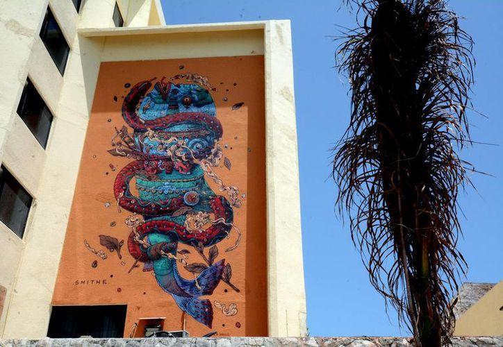 Un grupo de muralistas provenientes de varias partes del mundo que llenaron con su arte Isla Mujeres. (Redacción/SIPSE)