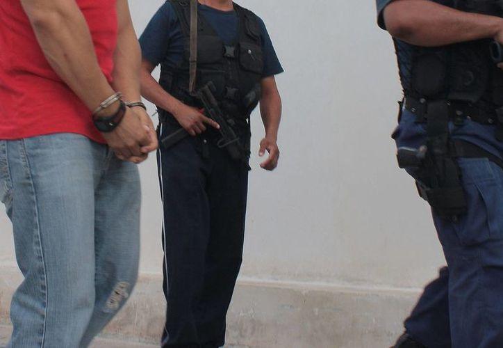 Un expolicía fue detenido tras sustraer una cartera de una vivienda. (Foto de contexto/SIPSE)