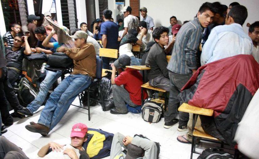 Entre los detenidos se encuentran nueve menores de edad. (EFE)