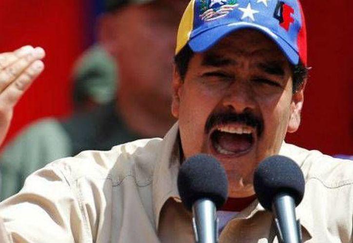 El mandatario, Nicolás Maduro, advirtió este jueves, durante un evento de entrega de casas, que sólo pueden gobernar Venezuela los 'revolucionarios', esto con respecto a las próximas elecciones  presidenciales. (Archivo/AP)