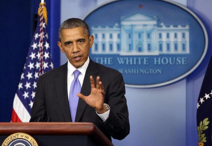 Oficialmente Obama ya dio el banderazo de reapertura del gobierno de Estados Unidos. (EFE)
