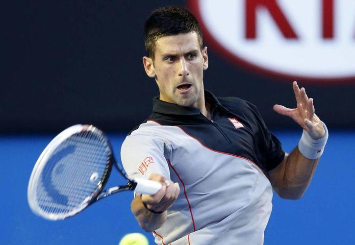 Pese a no jugar tenis al más alto nivel desde hace varia semanas, Djokovic se impuso al joven eslovaco Lukas Lacko 6-3, 7-6 (2) y 6-1. (Agencias)