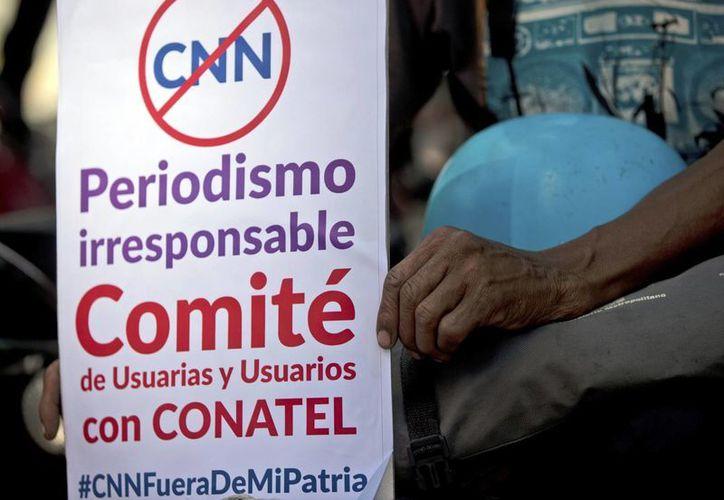 El gobierno de Venezuela amenaza con cerrar también la señal de CNN en Español por internet. (AP/Fernando Llano)