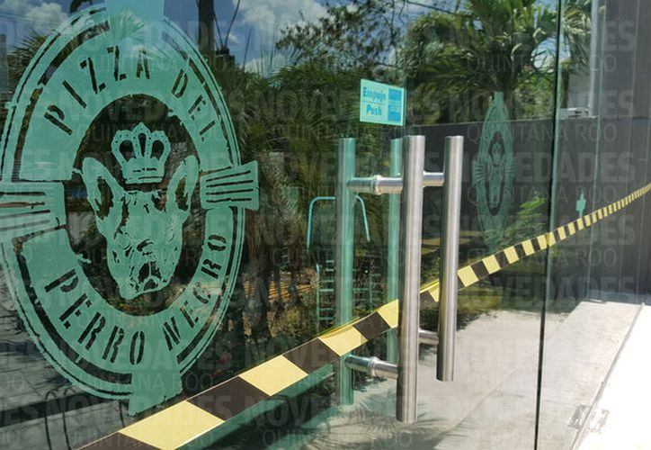 El restaurante Pizza del Perro Negro sufrió una amenaza de la delincuencia. (Jesús Tijerina/SIPSE)
