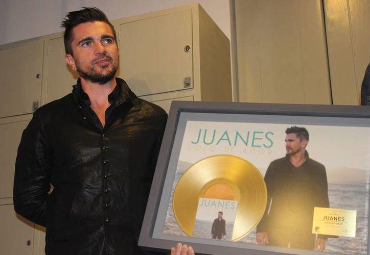 Juanes dijo que, aunque siempre ha tenido libertad para hacer y grabar lo que le gusta, por primera vez se siente realmente satisfecho con lo que hace. (Archivo Notimex)