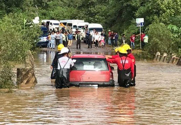 Hay daños en una 30 viviendas de la agencias de San Juan Chapultepec y San Martín Mexicapam. (Milenio)