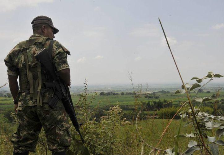 Las FARC rechazaron tener vínculos con un grupo paramilitar denominado Clan Úsuga. (EFE)