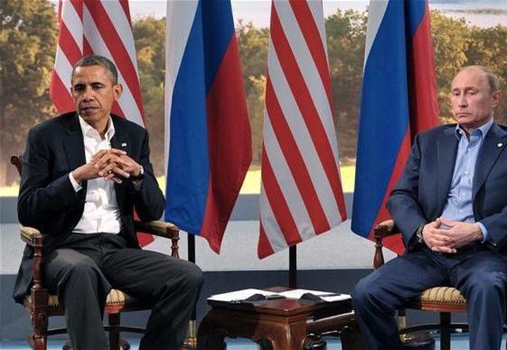Obama y Putin se encuentran enfrentados por la crisis en Ucrania. (Archivo/EPA)
