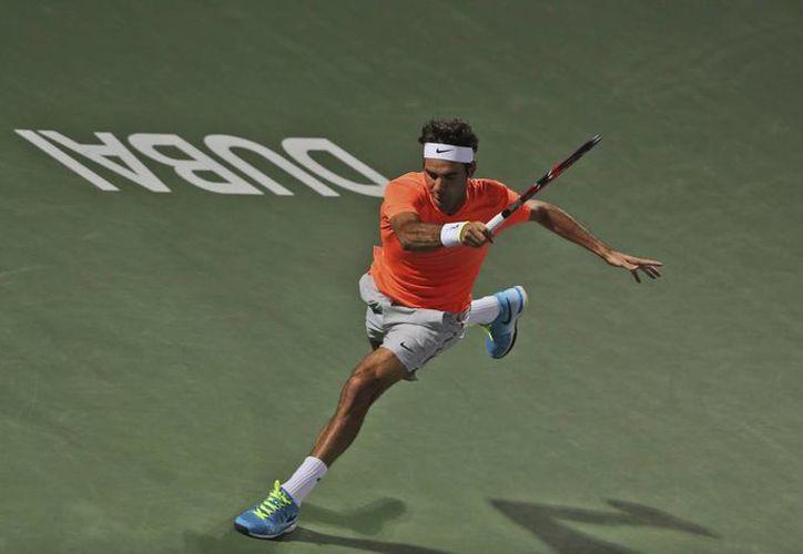 Federer venció a Youzny por la ocasión 16 en 16 partidos. Esta vez, en el campeonato de Dubai. (Foto: AP)