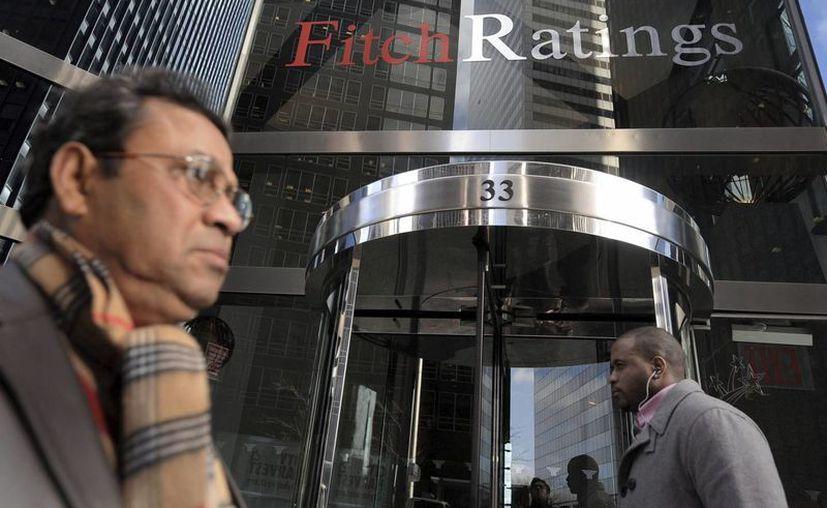 La agencia Fitch informa que Brasil cerrará el 2016 con un escenario económico adverso. (Archivo/EFE)