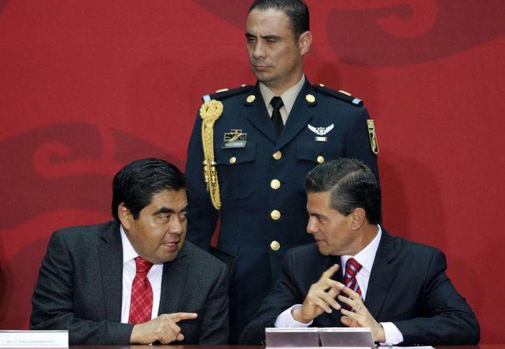 Peña Nieto anunciará la conformación de una Comisión para el Estado de Derecho, que entre otras cosas podría proponer la creación de una Policía Nacional. (Archivo/Notimex)