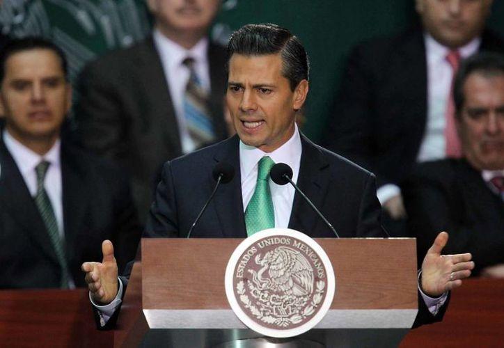 El presidente Enrique Peña Nieto dijo que en 2014 se redoblarán esfuerzos para que las reformas estructurales sean aplicadas. (Notimex)