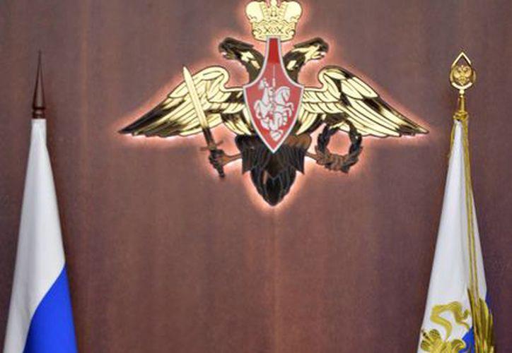 El presidente ruso, Vladimir Putin encabeza una reunión con funcionarios militares de alto rango en la sala de control del Ministerio de Defensa en Moscú, Rusia. (Agencias)