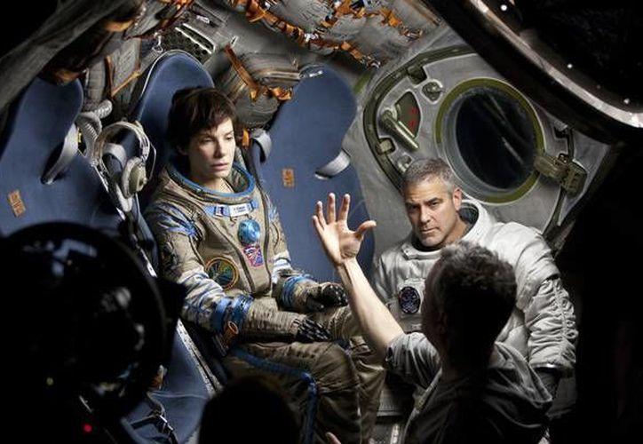 Protagonizan 'Gravedad' Sandra Bullock y Goerge Clooney. (Agencias)