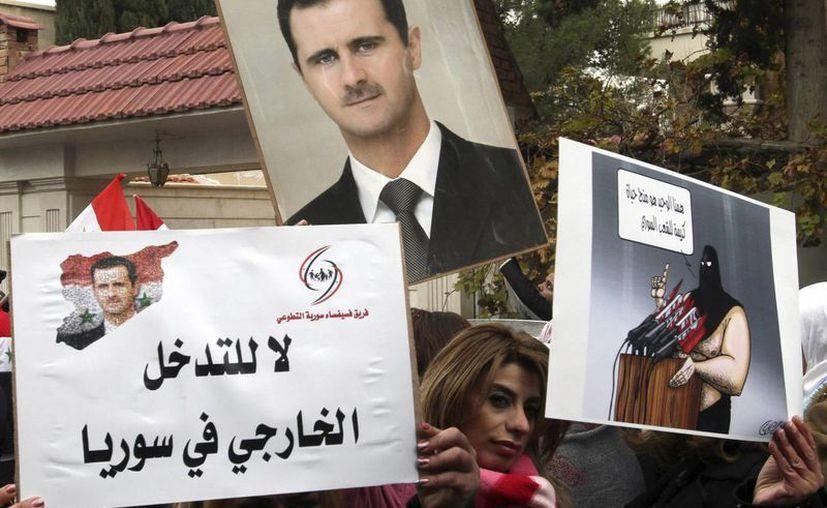La aparición de Al Assad ocurre en medio de una ola de sangre en Siria, con cientos de muertos en los últimos días. (EFE/Archivo)