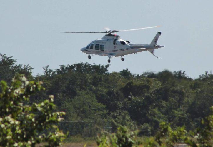El presidente viajó vía aérea a Cancún para presentarse en el Foro Nacional de Turismo (Gustavo Villegas/SIPSE)