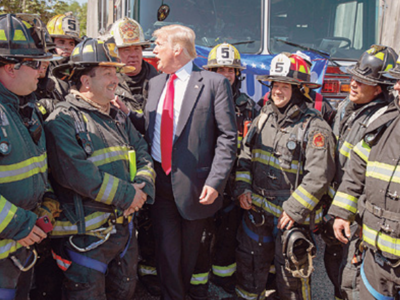 President Donald Trump talks with first responders after a roundtable event on immigration policy at Morrelly Homeland Security Center, in Bethpage, N.Y. (AP)