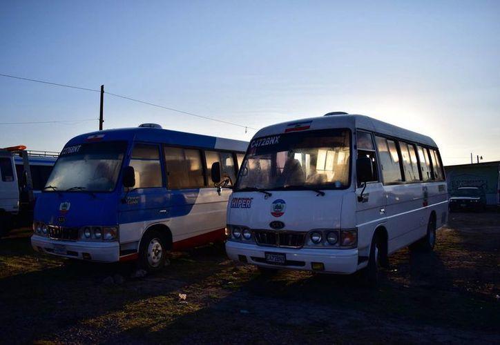 Autobuses que recorren las 12 zonas de Quetzaltenango, ciudad que vive bajo la amenaza de los extorsionadores. (EFE)
