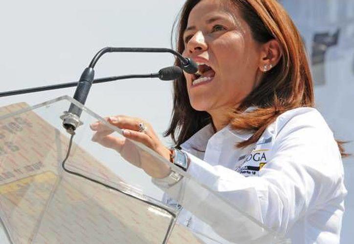 Karen Quiroga, la legisladora perredista que golpeó la noche de este miércoles a su colega, Landy Berzunza durante la aprobación de la Reforma Energética. (oem.com.mx)
