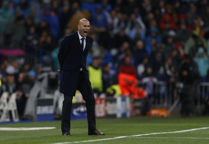 Zidane elogió la actuación de Cristiano Ronaldo en la victoria del Madrid sobre el Wolfsburgo 3-0. (AP)