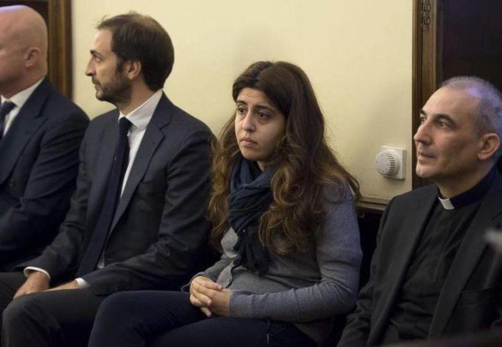 De izquierda a derecha, Nuzzi, Fittipaldi, Chaouqui y Lucio Ángel Vallejo Balda, durante su juicio en el Vaticano. El segundo fue dejado hoy en libertad. (Archivo/AP)