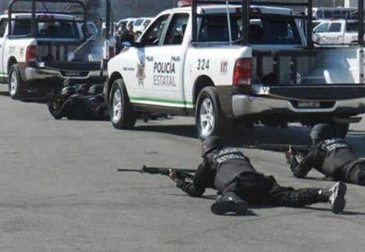Los enfrentamientos entre las autoridades y grupos delictivos dejó 14 muertos. (Milenio)