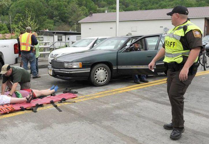 Trascendió que el conductor del vehículo sufrió un problema médico -no se especificó de qué tipo- antes de 'chocar' contra la gente en el desfile. (Agencias)