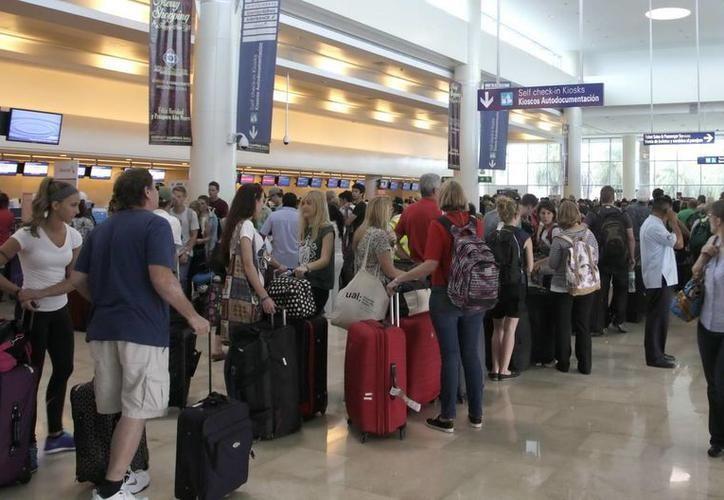 En el Aeropuerto  de Cancún, hay entre 500 y 600 operaciones programadas para esta temporada. (Foto: Contexto)