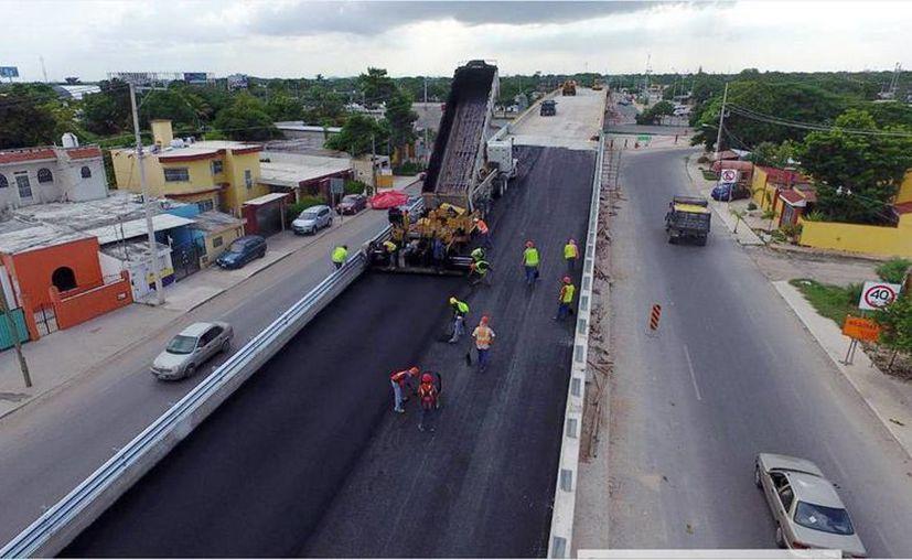 Los trabajos en el anillo periférico de Mérida registran un 95 por ciento de avance. Gracias a la construcción se agilizará y ordenará el paso de los vehículos. (Milenio Novedades)