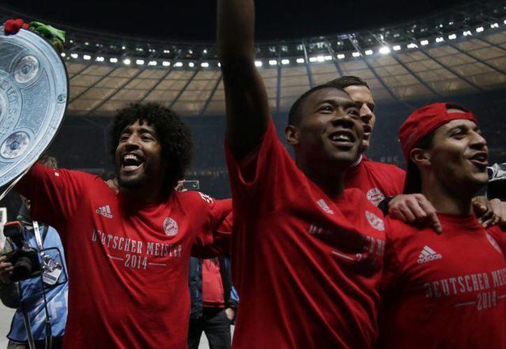 Nunca antes en la historia de la Bundesliga, un club se había coronado a falta de siete partidos por jugarse. El Bayern lo logró hoy. (Agencias)