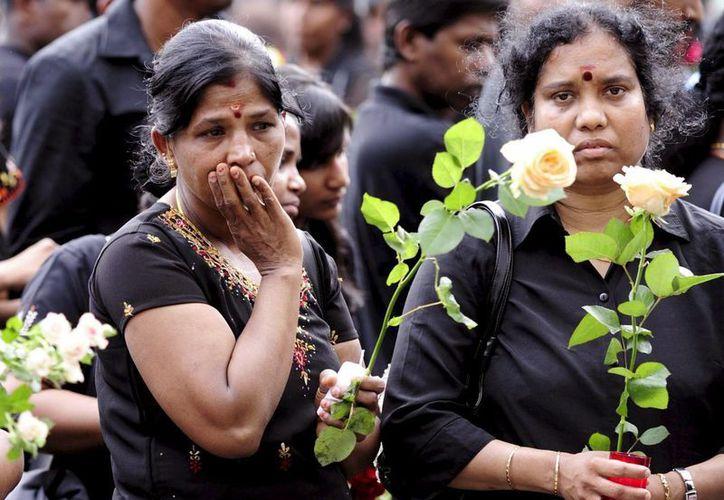 Mujeres de la etnia tamil participa en una concentración en Zúrich, para homenajear a las víctimas de la guerra civil de Sri Lanka. (Archivo/EFE)